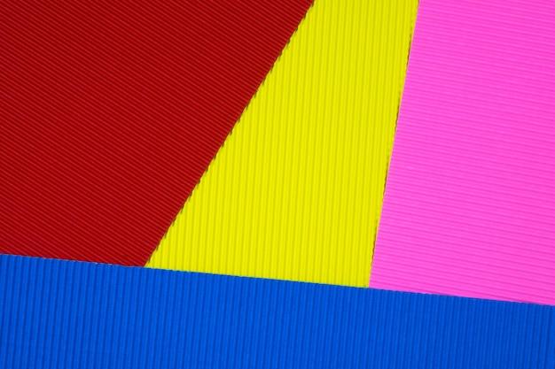 Multi farbiger wellpappenbeschaffenheitshintergrund. Premium Fotos