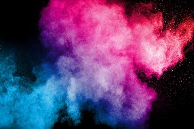 Multi farbpulverexplosion auf schwarzem hintergrund. Premium Fotos