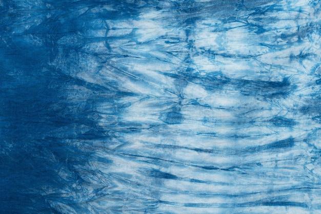 Muster der blauen färbung auf baumwollstoff, gefärbter indigogewebehintergrund und gemasert Premium Fotos