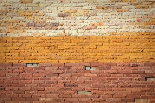 Muster der bunten modernen backsteinmauer aufgetaucht. Premium Fotos