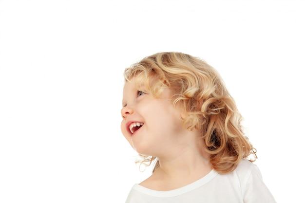 Nachdenkliches kleines kind, das oben schaut Premium Fotos