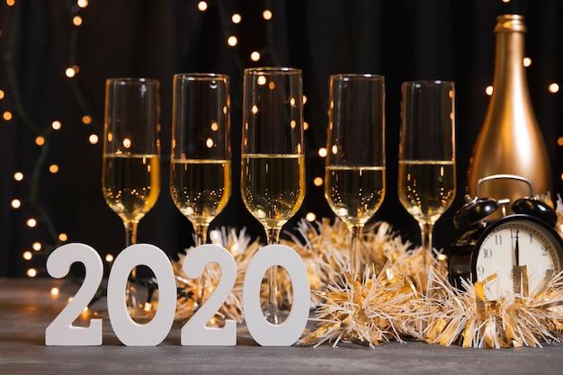 Nacht des neuen jahres der vorderansicht mit champagner Kostenlose Fotos