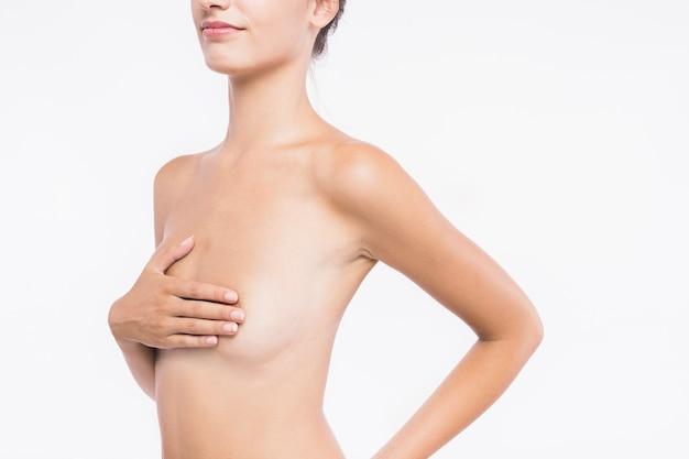 Nackte mit der hand auf der brust Kostenlose Fotos