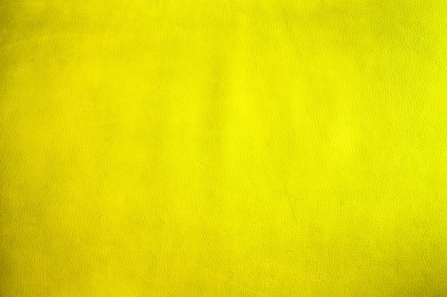 Nahaufnahme auf altem gelbem leder- und beschaffenheitshintergrund Premium Fotos