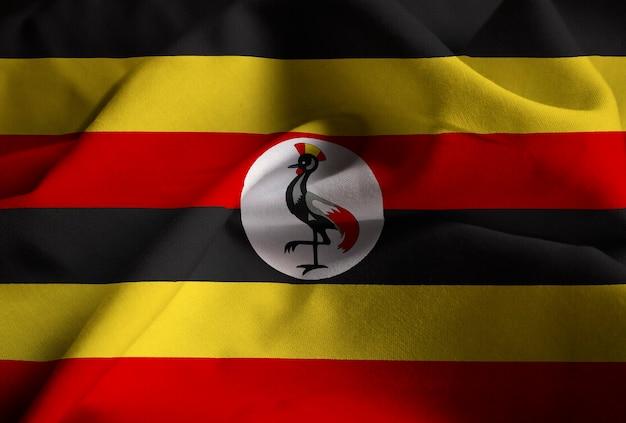 Nahaufnahme der gekräuselten uganda-flagge, uganda-flagge, die im wind durchbrennt Premium Fotos