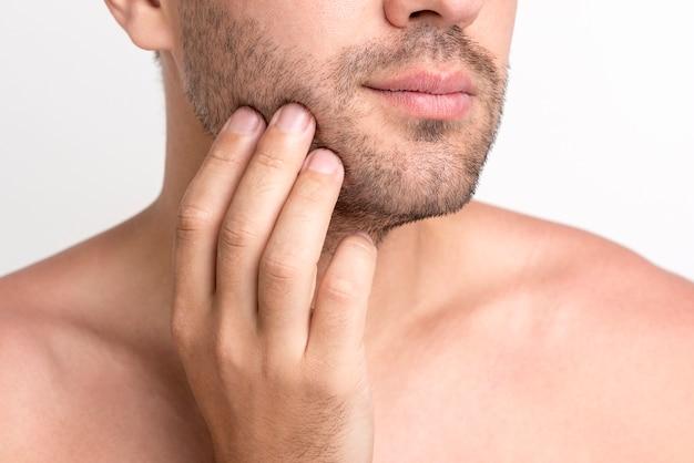 Nahaufnahme der hand des mannes sein gesicht berührend Kostenlose Fotos