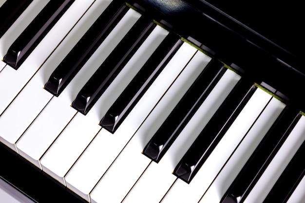 Nahaufnahme der klaviertastaturhintergrund Premium Fotos