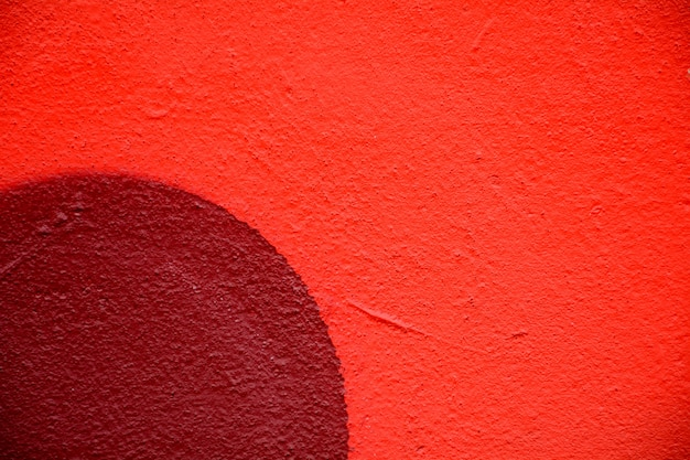 Nahaufnahme der roten zementwand Premium Fotos