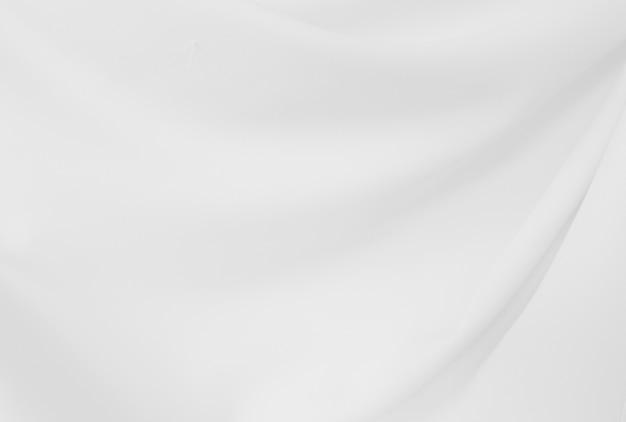 Nahaufnahme elegant zerknittert vom weißen seidengewebestoff und -beschaffenheit. Premium Fotos