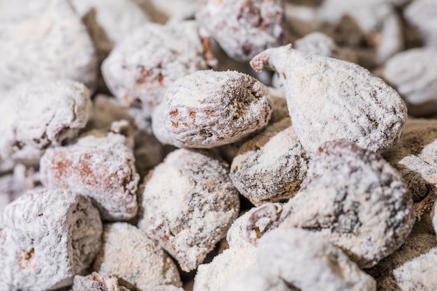 Nahaufnahme von bonbons mit puderzucker Kostenlose Fotos