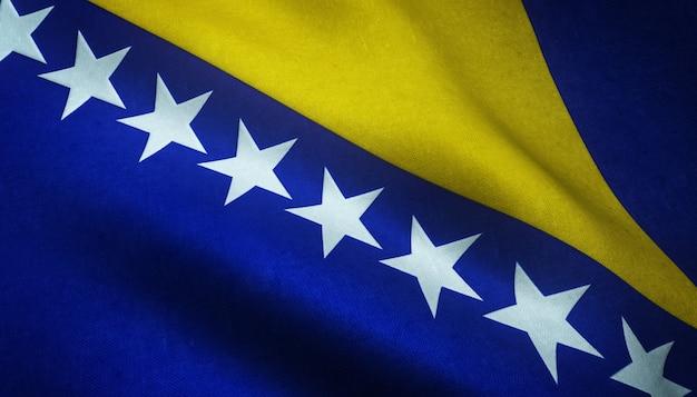 Nahaufnahmeaufnahme der flagge von bosnien und herzegowina mit grungy texturen Kostenlose Fotos