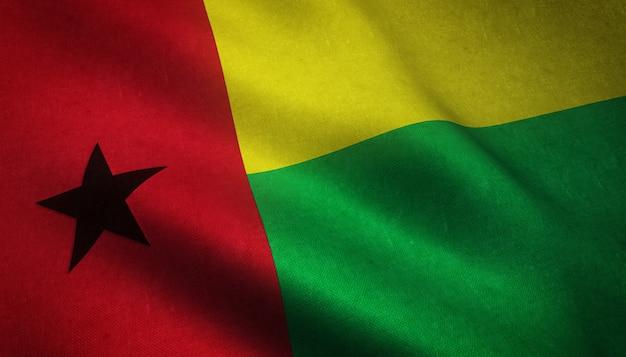 Nahaufnahmeaufnahme der wehenden flagge von guinea-bissau mit interessanten texturen Kostenlose Fotos