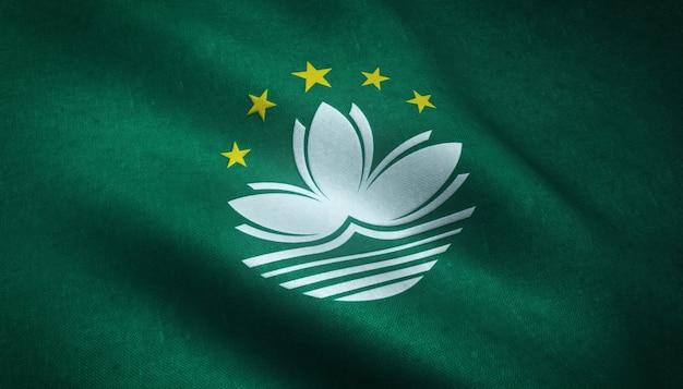Nahaufnahmeaufnahme der wehenden flagge von macau mit interessanten texturen Kostenlose Fotos