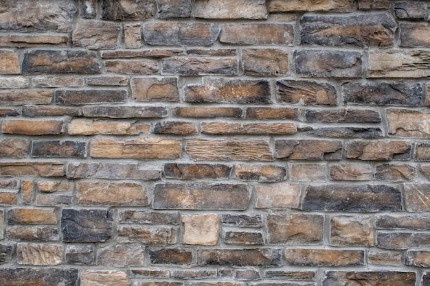 Nahaufnahmeaufnahme eines backsteinmauer-texturhintergrunds Kostenlose Fotos