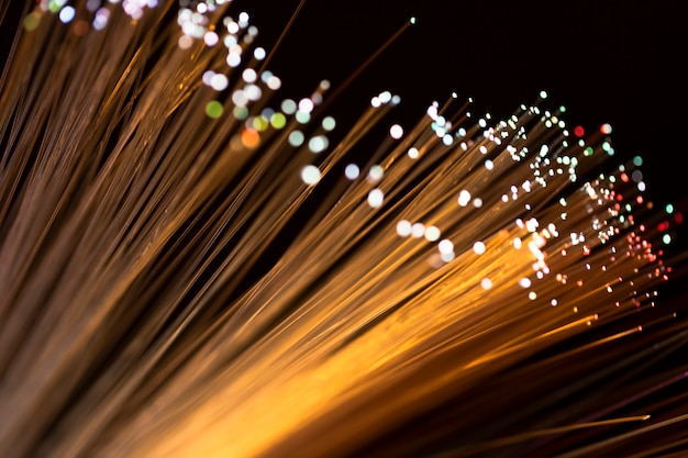 Nahaufnahmefaseroptiklichter in den goldenen schatten Kostenlose Fotos