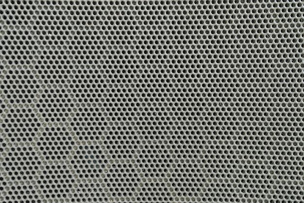 Nahaufnahmeoberfläche des schwarzen metalllautsprechers an der tür des strukturierten hintergrundes des autos Premium Fotos