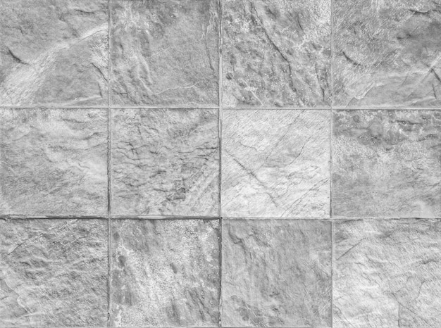 Nahaufnahmeoberflächen-ziegelsteinmuster an der ziegelsteinsteinwand maserte hintergrund im schwarzweiss-ton Premium Fotos