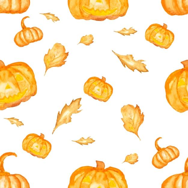 Nahtlose aquarellfarbe von halloween. kürbis und getrocknetes blatt. Premium Fotos