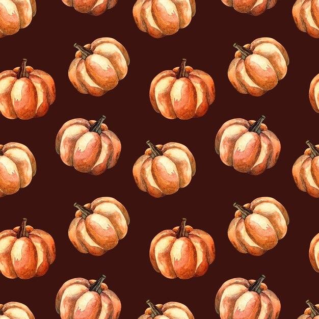 Nahtloses aquarellmuster mit einem orange kürbis auf dunklem hintergrund, aquarellillustration mit gemüse Premium Fotos
