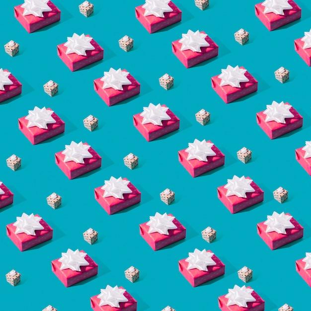 Nahtloses muster von rosa geschenkboxen Kostenlose Fotos