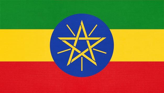 Nationale gewebeflagge der republik äthiopien, textilhintergrund. symbol des afrikanischen weltlandes. Premium Fotos