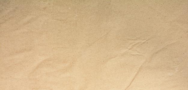 Natürliche braune recyclingpapierstruktur - hintergrund Premium Fotos