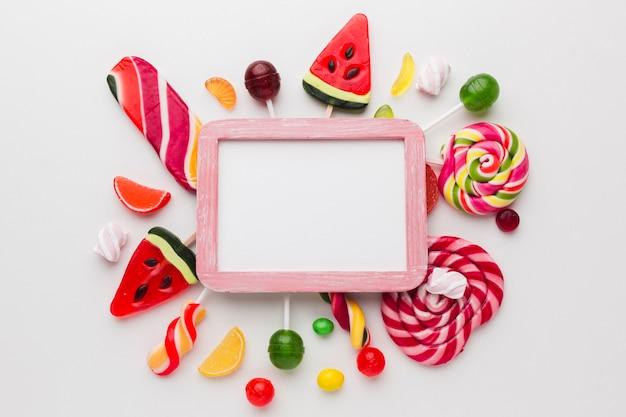 Netter süßigkeitsrahmen mit kopienraum Kostenlose Fotos