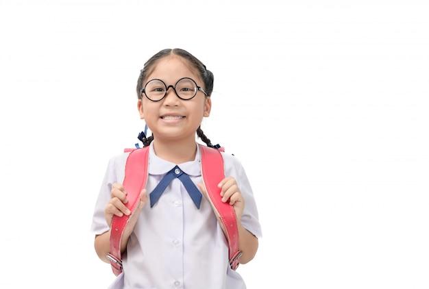 Nettes asiatisches studentenlächeln und tragen schultasche Premium Fotos