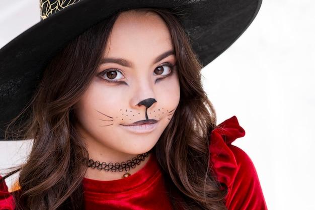 Nettes junges mädchen mit halloween-make-up Kostenlose Fotos