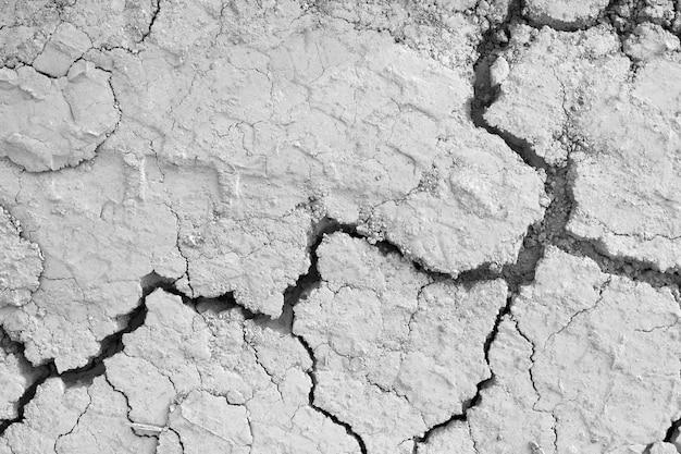 Oben ansicht der bodengrauen risse in der wüste. Kostenlose Fotos
