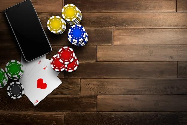 On-line-kasino, bewegliches kasino, draufsicht eines handys, chipkarten auf holz Premium Fotos