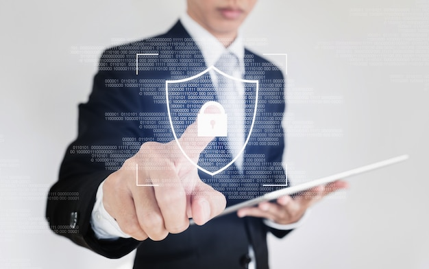 Online-datensicherheitssystem und netzwerk-cyber-sicherheitstechnologie. geschäftsmannscanfinger auf schirm zum entsperren des sicherheitssystems Premium Fotos