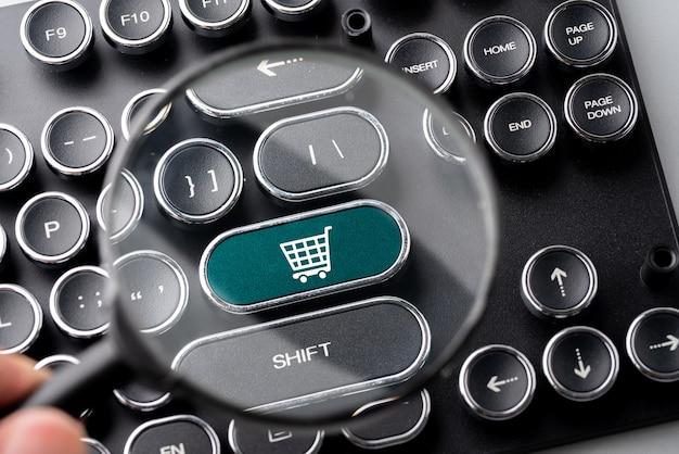 Online-shopping & business-symbol auf retro-computer-tastatur Premium Fotos