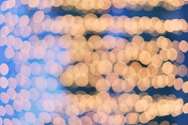 Orange bokeh, bokeh hintergrund, bokeh licht, blauer hintergrund und orange bokeh Premium Fotos
