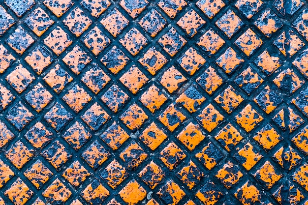 Orange farbbeschaffenheit und -hintergrund der metallplatte Premium Fotos