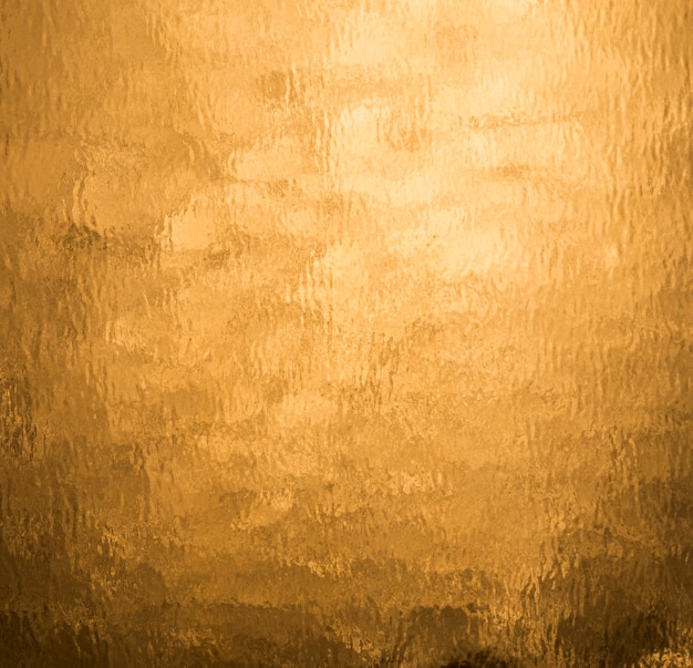 Orange folie des goldhintergrundes Premium Fotos