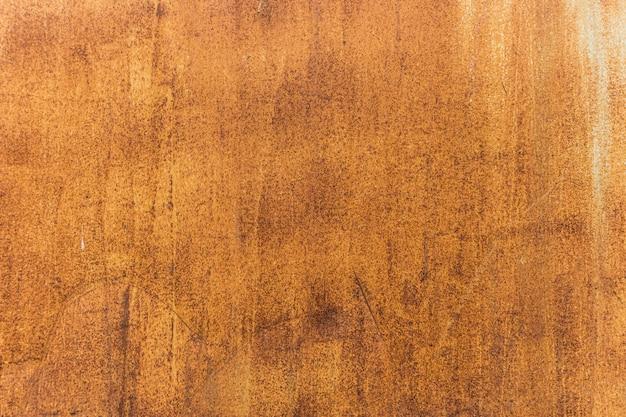 Orange getragener rostiger metallbeschaffenheitshintergrund Premium Fotos