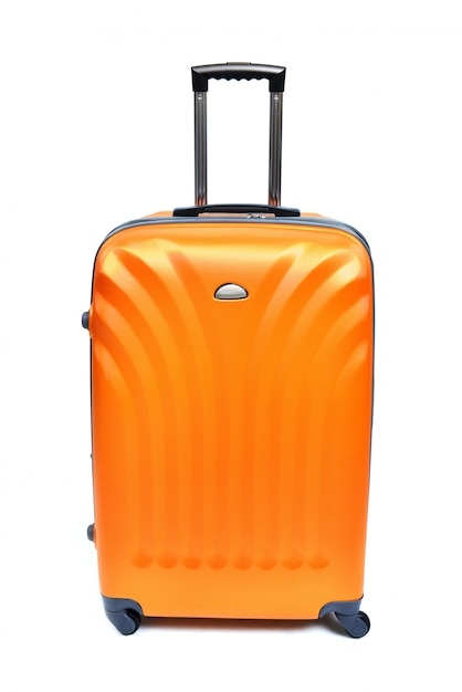 Orange koffer getrennt auf weiß Premium Fotos