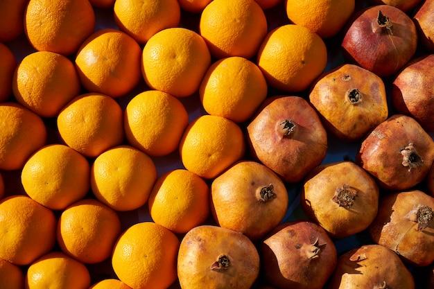 Orange und granatapfel Premium Fotos