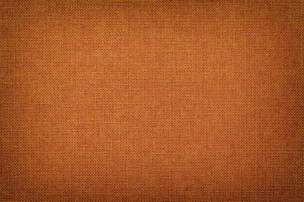 Orange von einem textilmaterial mit weidenmuster, nahaufnahme. Premium Fotos
