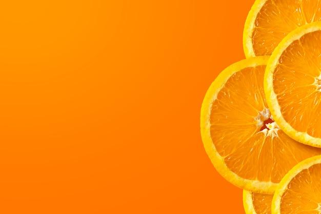 Orangenfrucht auf gelbem und rotem hintergrund Premium Fotos