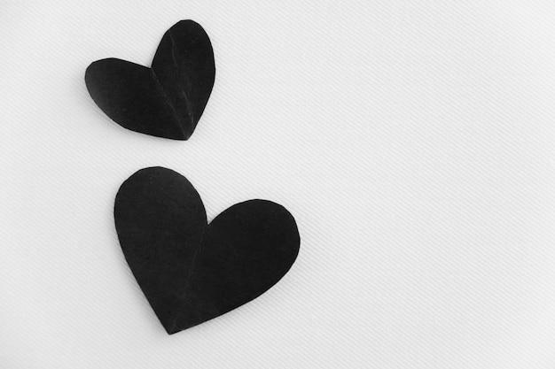 Paar schwarze herzen sind unsterbliche liebe, für immer beziehung Premium Fotos