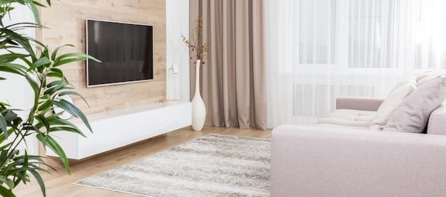 Panoramabild eines geräumigen wohnzimmers Premium Fotos