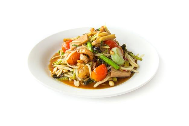 Papaya würzige salatmischung zutaten (tum pha poo pla ra) Premium Fotos