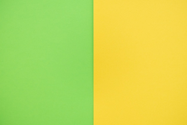 Papierhintergrund von zwei farben gelb und grün. Premium Fotos