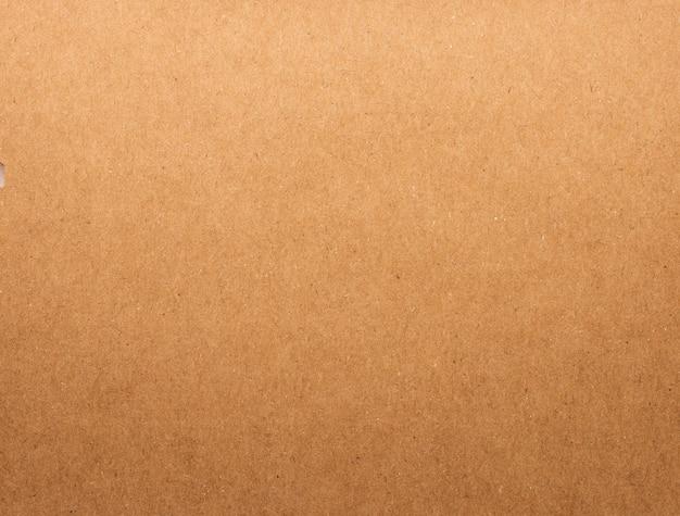 Pappbeschaffenheitshintergrund. braunes papiermaterial. leere pappe. Premium Fotos