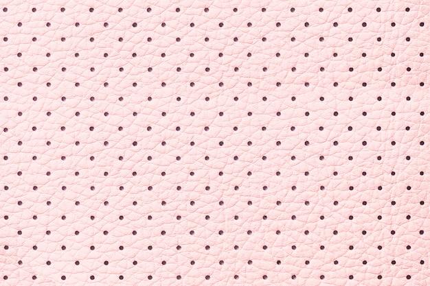 Perforierter rosa lederner beschaffenheitshintergrund, nahaufnahme Premium Fotos