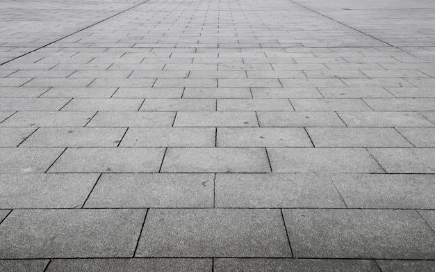 Perspektivische ansicht von monotonem grey brick stone Premium Fotos
