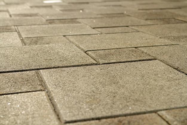 Pflaster aus grauem granit. Premium Fotos