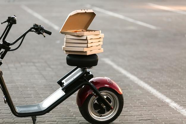 Pizzakartons bei lieferung motorrad Kostenlose Fotos